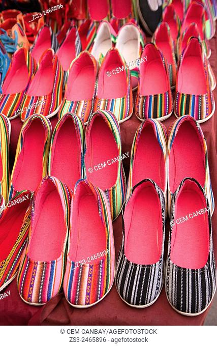 Traditional shoes for sale at the market, Pisaq, Sacred Valley, Peru, South America