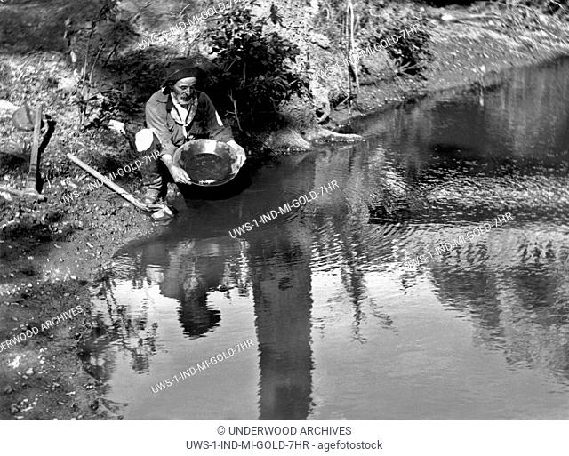 California: c. 1885.A gold miner panning for gold in California