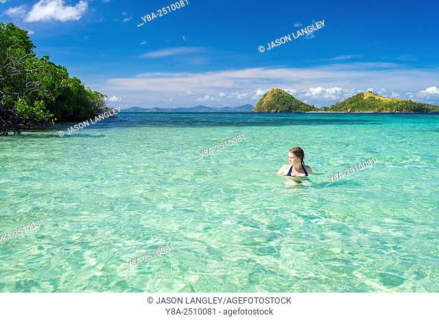 Woman swimming on CYC Island, Coron, Palawan, Philippines