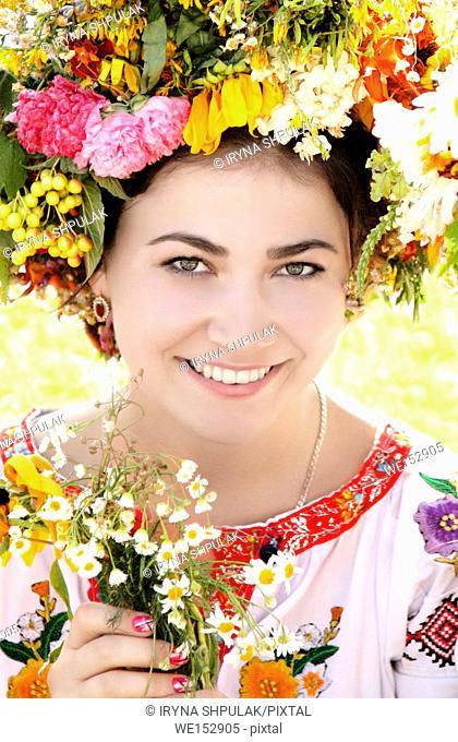 Young woman in Ukrainian traditional national costume, Ivan Kupala Day celebration, Kiev, Pirogovo, Ukraine