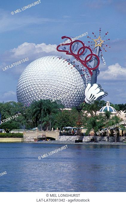 Epcot. Golf ball. Spaceship Earth. Millennium 2000 figures in red on side. Lake