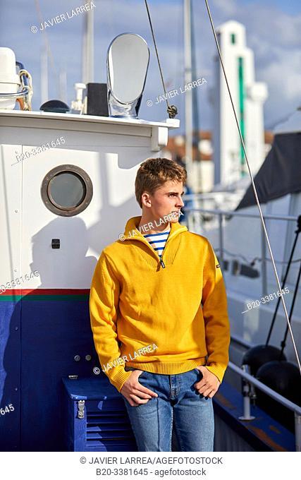 Young man in the harbour, Port De Plaisance Larraldenia, Ciboure, Aquitaine, Basque Country, France