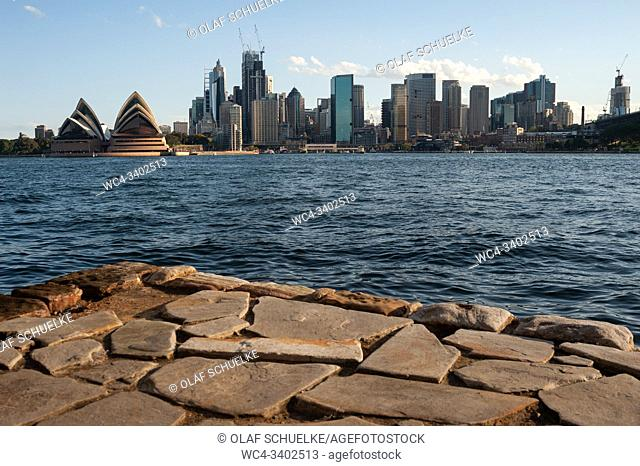Sydney, New South Wales, Australia - View from the waterfront in Kirribilli at the city skyline with central business district and Sydney Opera House
