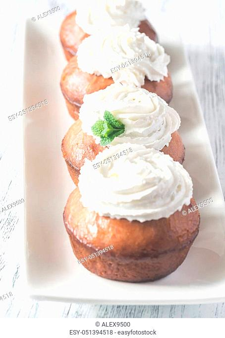 Rum baba on the plate arranged in a row