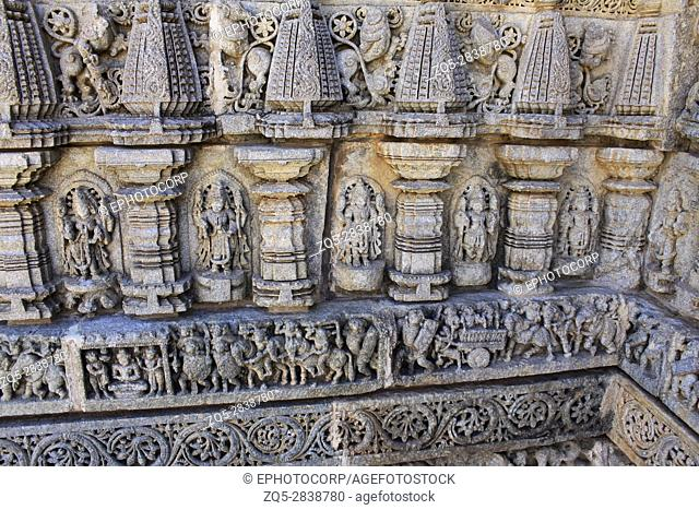 Close up of stone carvings, of deities, sculptures include of depictions of affluence of that age including members of the royal family riding richly decorated...