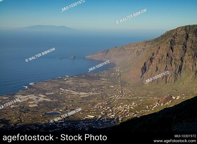 Spain, Canary Islands, El Hierro Island, La Frontera elevated view of La Frontera town and caldera from highway HI 1, sunset