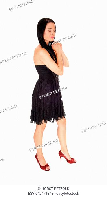 A full body image of a beautiful woman praying with her hands folded.and long black hair, eye's are closed, isolated for white background