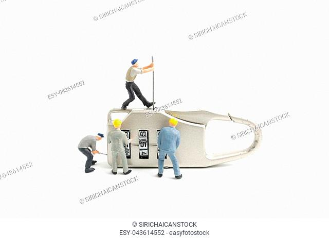 Miniature people worker : Teamwork helps to unlock password on the keys. Team work concept