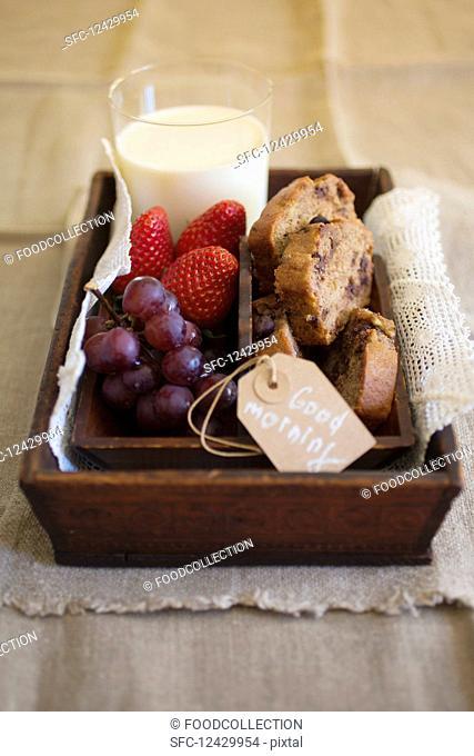 Breakfast with banana bread, fruit and milk