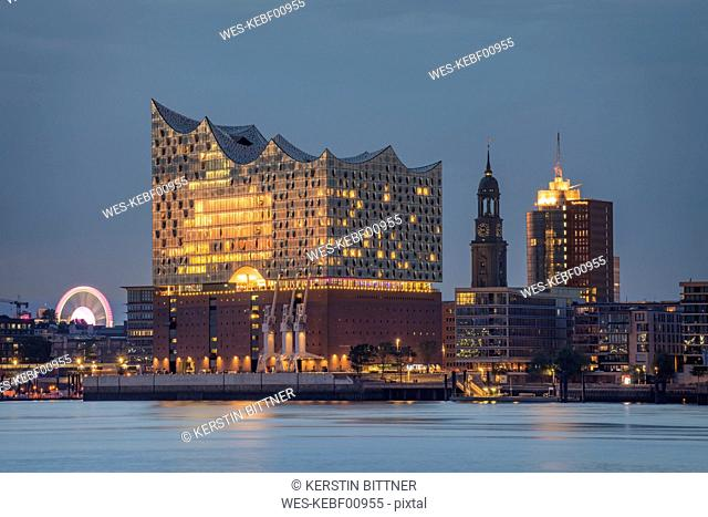 Germany, Hamburg, Elbe Philharmonic Hall, St. Michaelis Church at blue hour