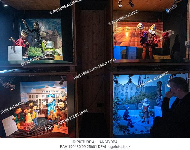 """30 April 2019, Bavaria, Augsburg: In the Augsburg puppet theatre museum """"""""Die Kiste"""""""", puppeteer Stefan Schmieder looks at a scenario depicting four Fugger..."""