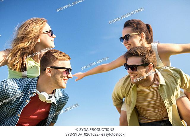 happy teenage friends having fun in summer
