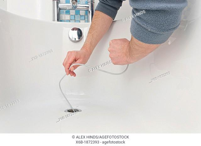 Drain python tool for cleaning and unblocking sink drains
