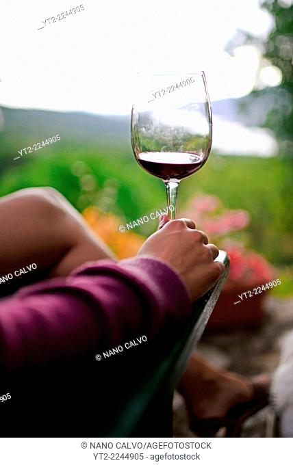 Young woman enjoys a cup of wine
