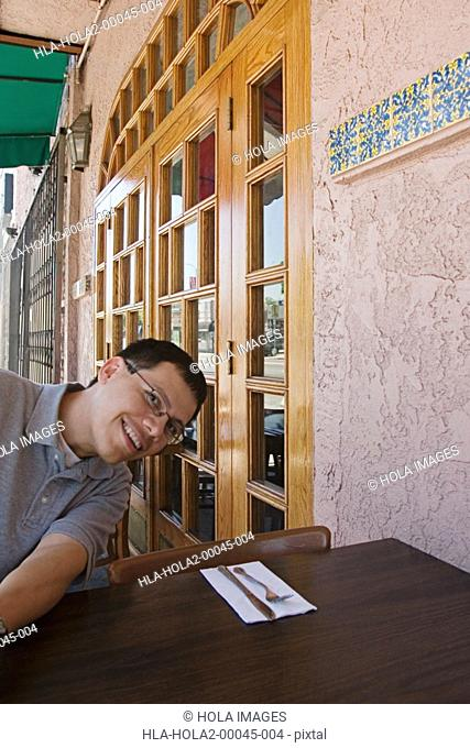 Man sitting at outdoor restaurant