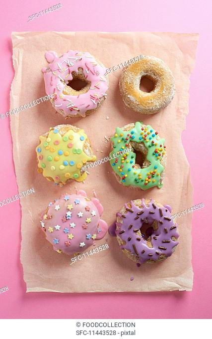 Doughnuts with glaze on a pink surface