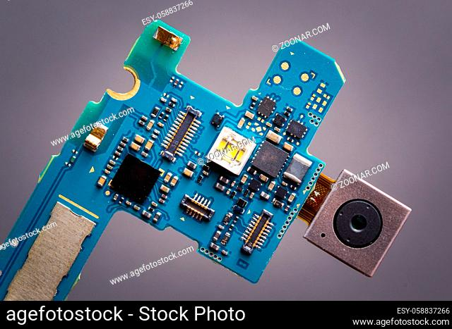 blue circuit board from smartphone with camera next to sim card slot