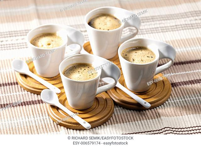 cups of coffee on place mats