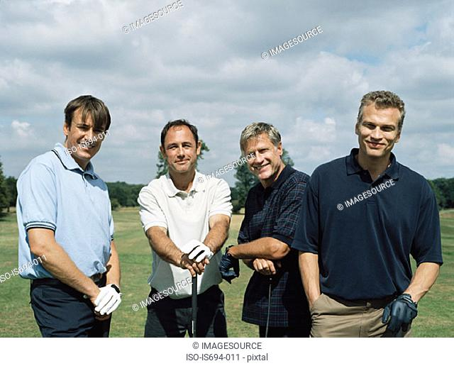 Rear view of four golfers