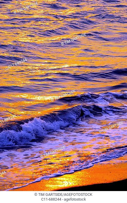 Sunset reflected on sea waves, Florida, USA