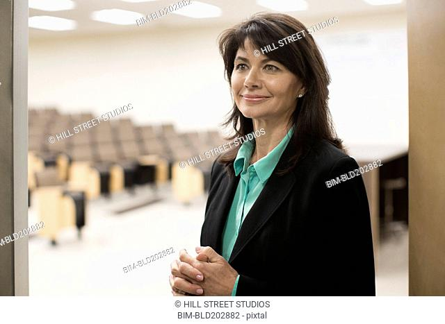 Caucasian teacher in empty classroom