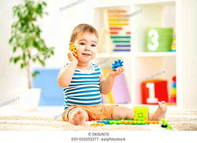funny kid boy playing at home or at kindergarten