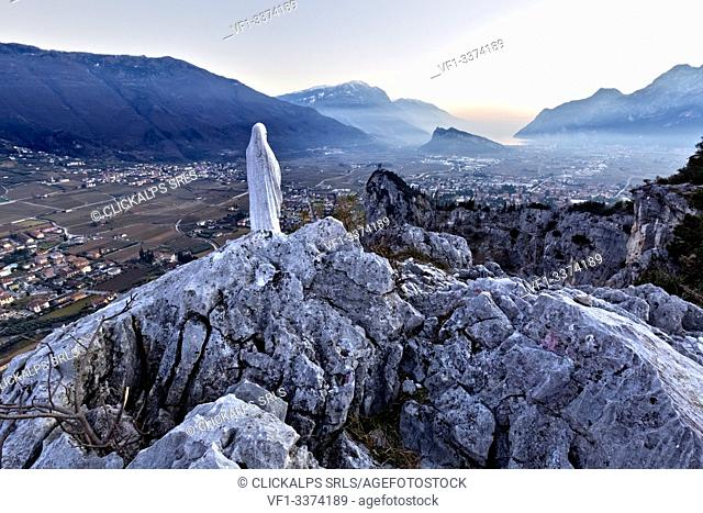 The statue of the Madonna on Mount Colodri overlooks the Alto Garda. Arco, Trento province, Trentino Alto-Adige, Italy, Europe