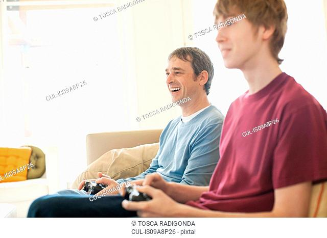 Father and grown up son playing video game
