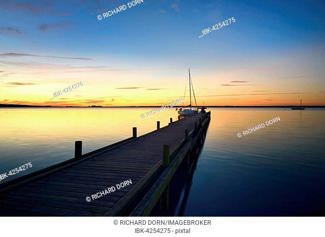 Jetty, sailing boat, sunset, Lake Steinhuder, Steinhude, Lower Saxony, Germany