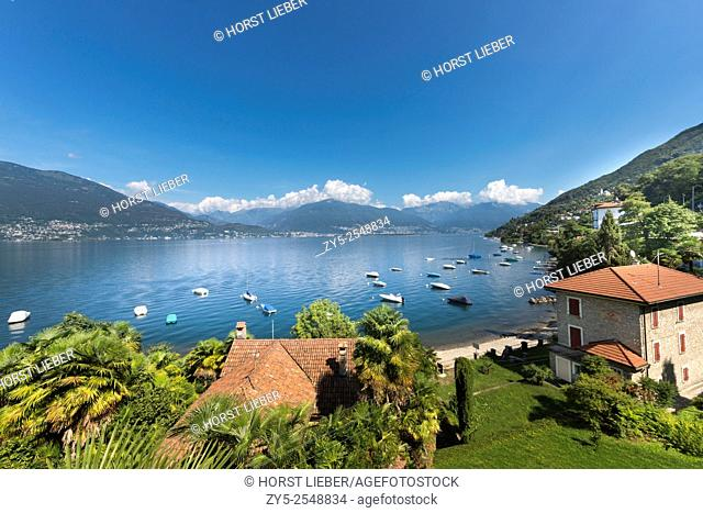 Overlooking the Swiss part of Lake Maggiore, in the background Ascona, Locarno and Brissago . Lake Maggiore. Italy