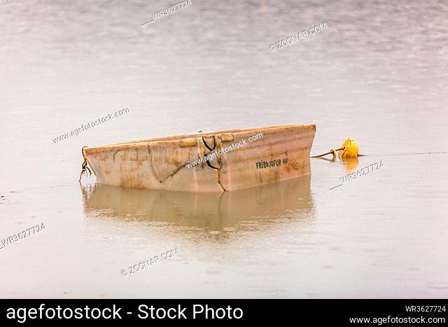 white plastic box and a yellow buoy flote on the lake Lagarfljot