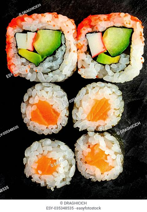 mixed sushi plate with maki and uramaki california rolls