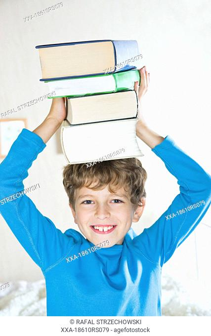 boy with pile of books