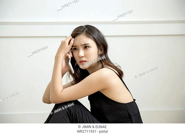 Side view of young woman depressed