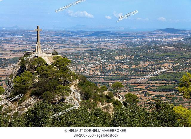 View of Majorca and a stone cross, Santuari de Sant Salvador Monastery, Santuario de San Salvador, near Felanitx, Majorca, Balearic islands, Spain, Europe