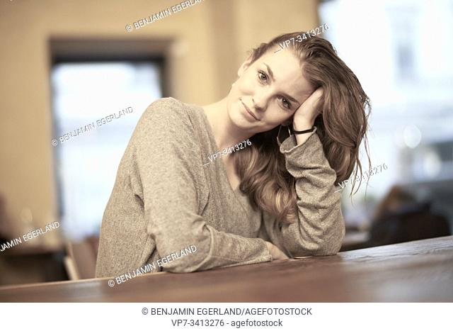 Young woman in café, Munich, Germany