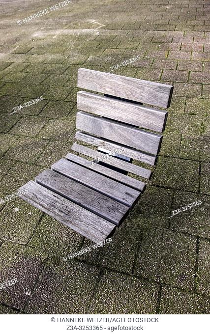 Chair in a public space, Rotterdam, The Netherlands, Europe
