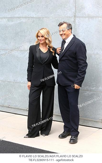 The film director Gabriele Muccino guest of Giorgio Armani fashion show poses for photographers with wife Angelica Russo at Milan fashion woman 2016, Milan