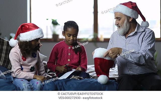 Family getting ready to play secret santa on xmas