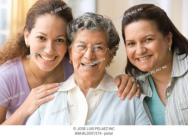Portrait of Hispanic grandmother, mother and daughter