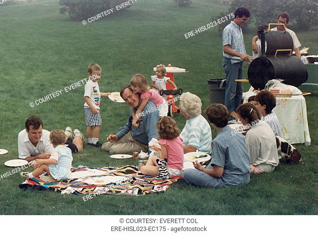 Vice President Bush picnics on the lawn of his Kennebunkport home with his family including many young grandchildren. Ca. 1984. BSLOC-2011-3-98