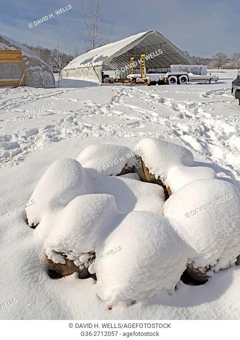 Winter snow covers an artisanal organic farm in Johnston, Rhode Island, USA