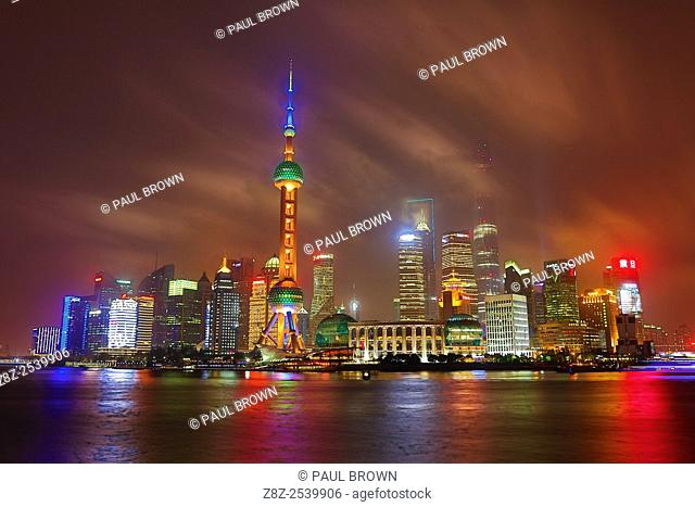 General view of the Pudong city skyline in Shanghai at night with the Oriental Pearl TV Tower, Shanghai, China