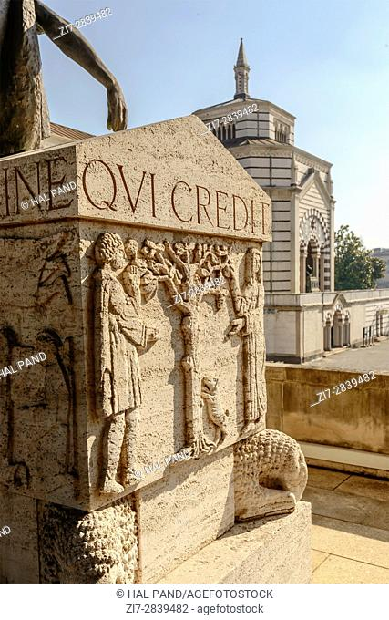 view of sculpted stone graveyard at large monumental Cemetery in town, shot in Milan, Lombardy, Italy