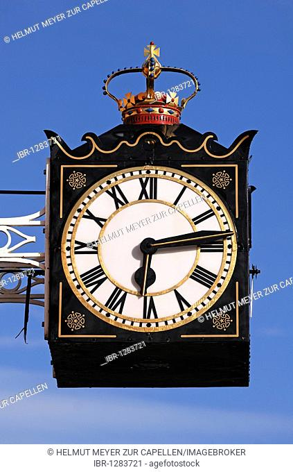 Old clock with a crown on a building against a blue sky, Chester Road, Brownhills, Staffordshire, England, United Kingdom, Europe