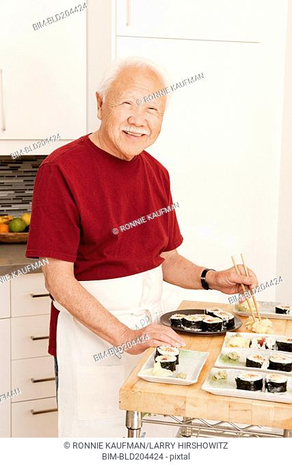 Japanese man cooking in kitchen