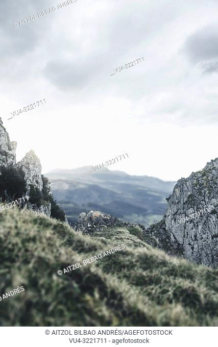 This shot is perfect to place a person into it, I have a version of me in the center of the rock. Basque mountains