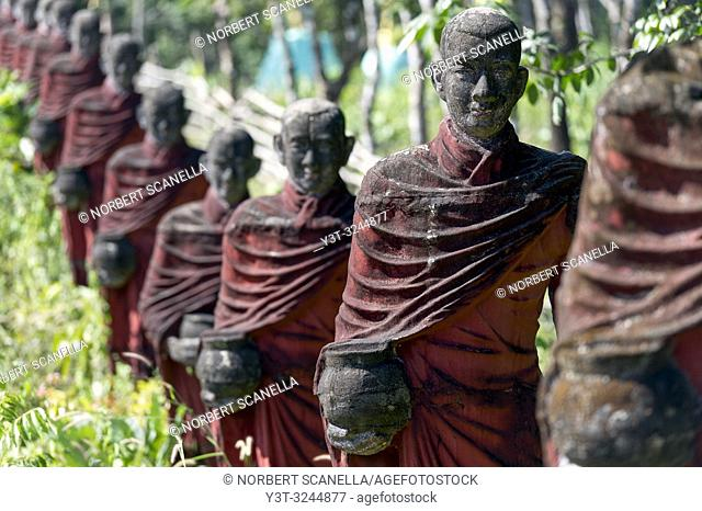 Myanmar (formerly Burma). Mon State. Yadana Daung Mawlamyine (Moulmein) surroundings, Win Sein Taw Ya temple. Row of statues of the 500 Arahant followers of...