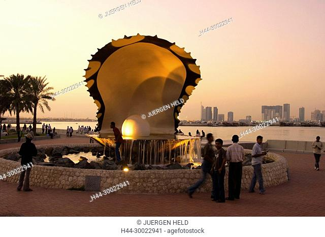Qatar Doha oyster fountain with pearl along the shore of Doha at sunset