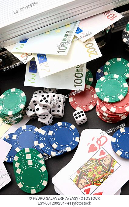 background gambling with euro banknotes, casino chips, cards and dices